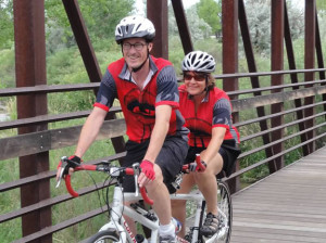 Photo of captain and stoker on bike crossing bridge