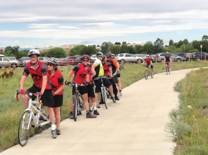 Photo of a group of Eyecycle riders in a park getting ready to ride.