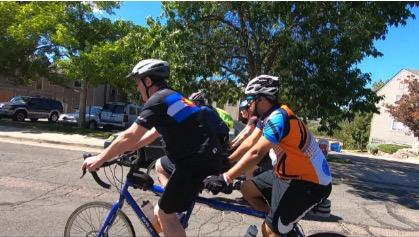 bikers riding tandem